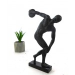 A discus thrower is depicted about to release his throw
