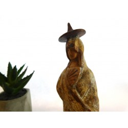 Tanagra figurine holding a fan