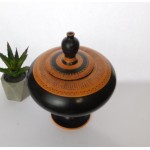 Red figure vessel with a lid